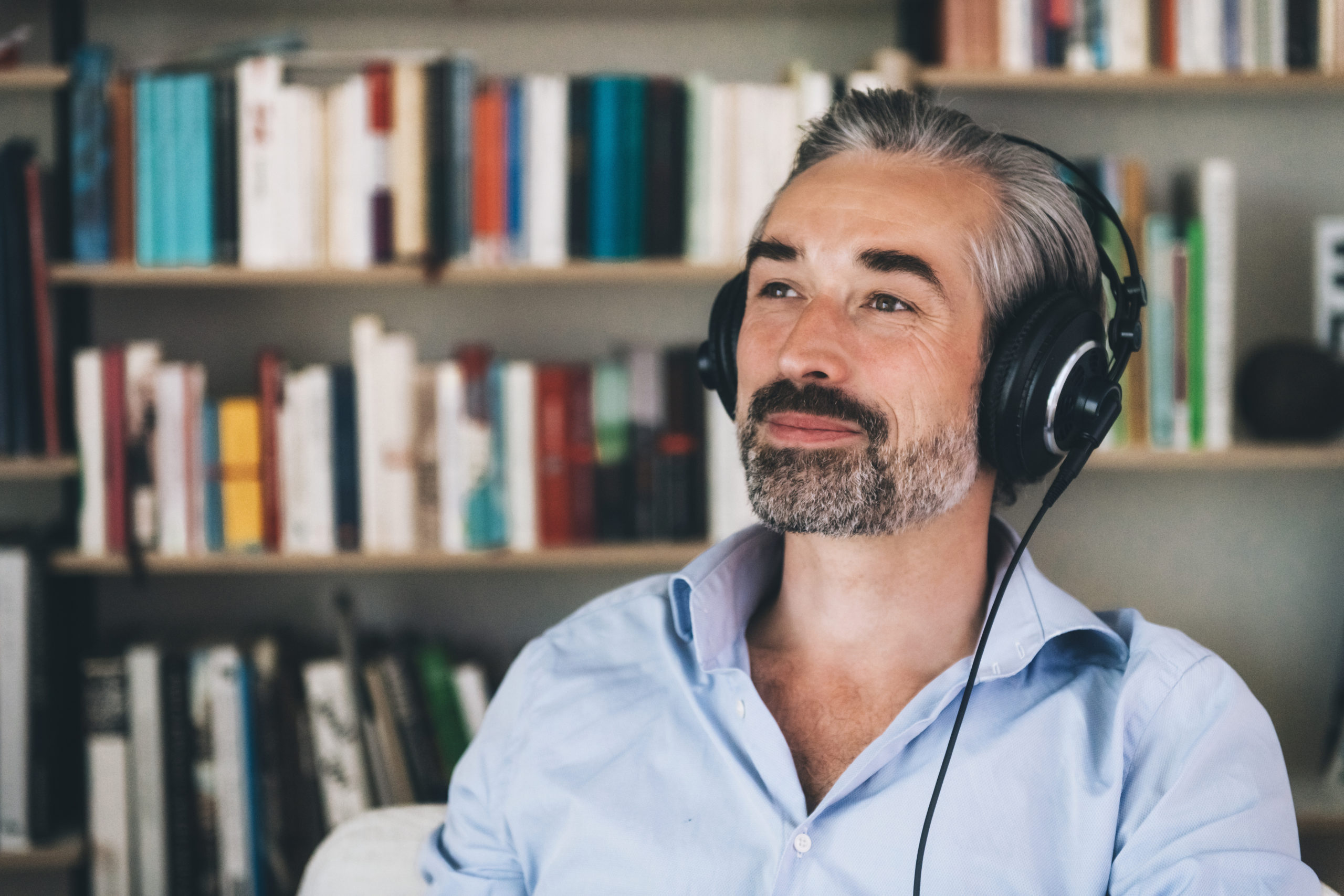 man listening with headset on
