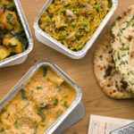 dishes of Indian takeout in Manassas
