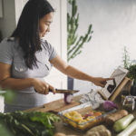 woman cooking with healthy ingredients from health food stores