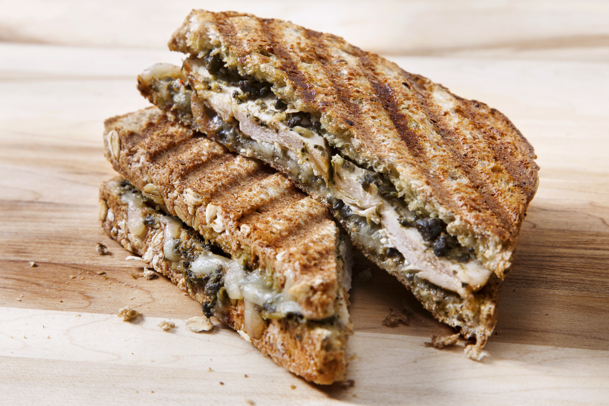 panini sandwich on a light wood background