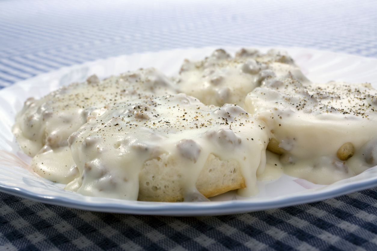 sausage gravy and biscuits on a plate
