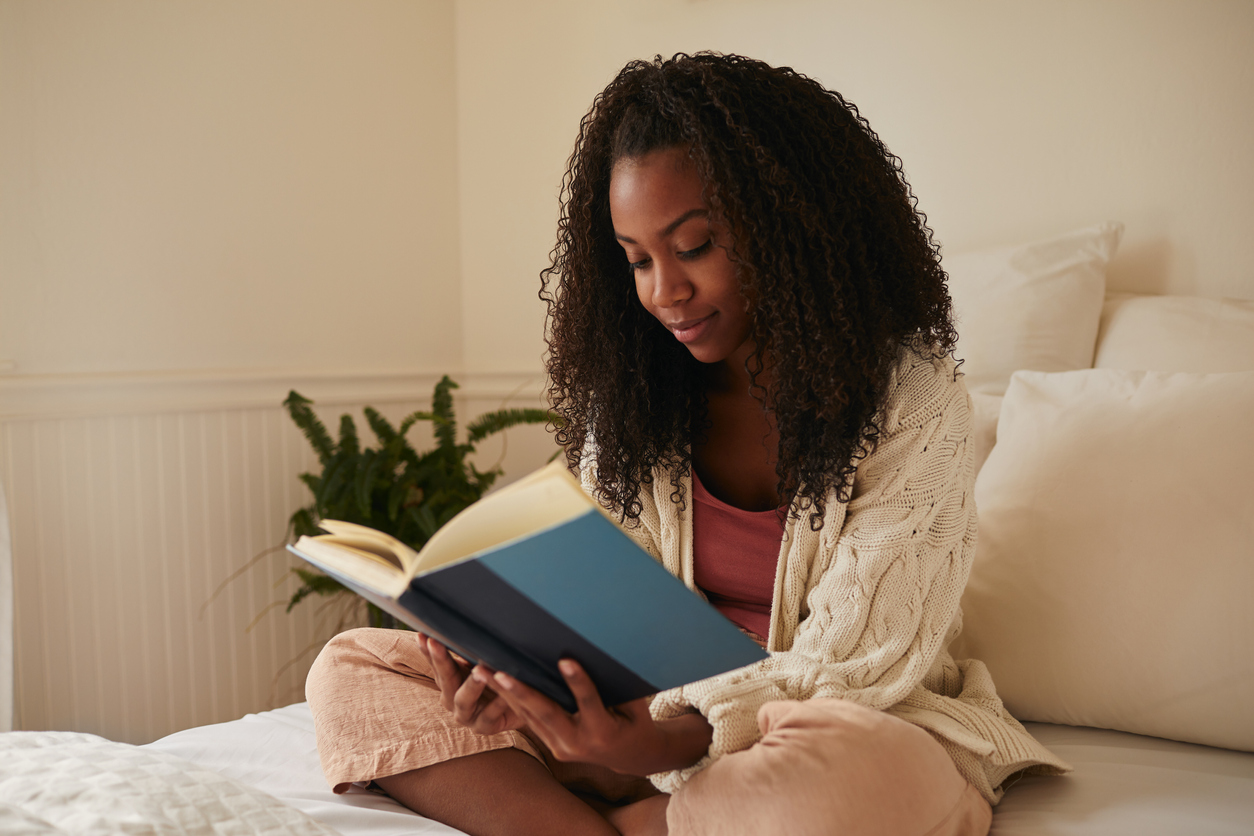 woman reading a book at home | Relaxing Day in Manassas