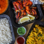 takeout dishes of chicken and rice | Indian cuisine around Manassas