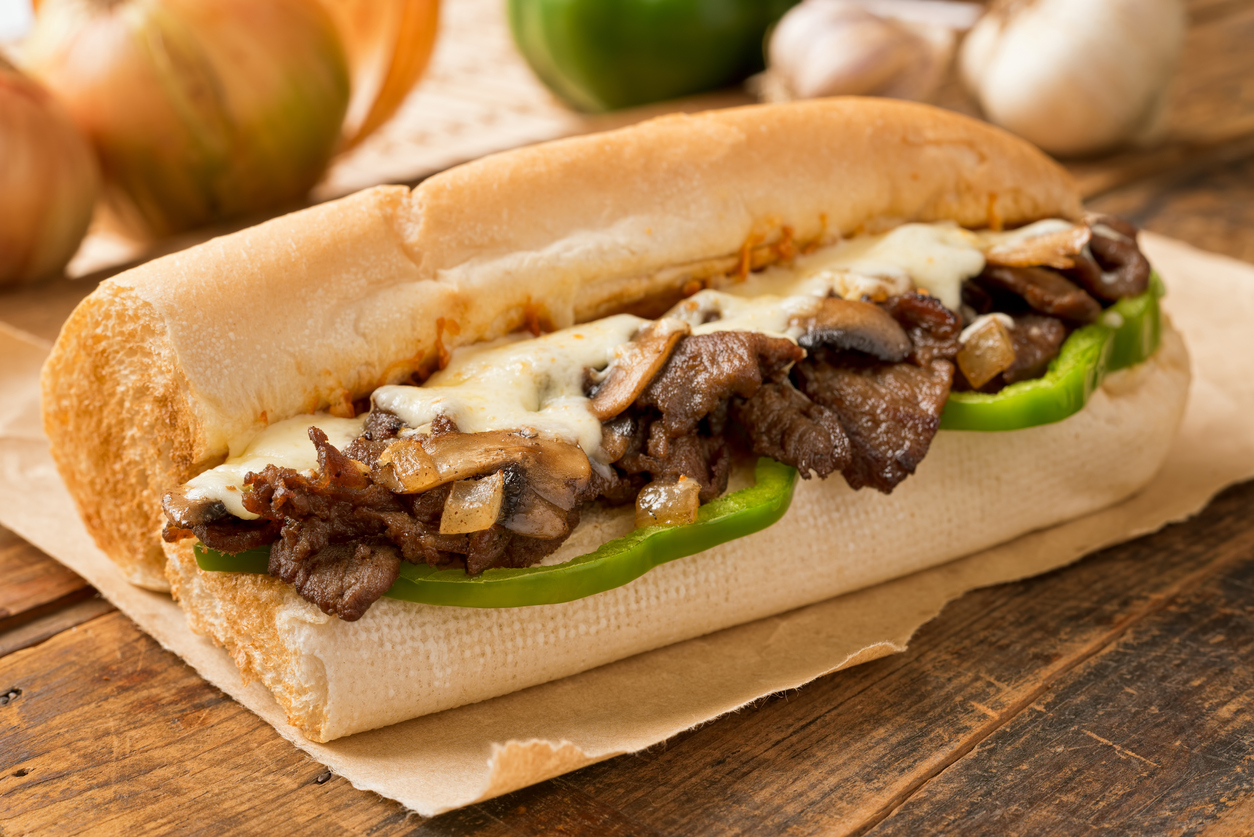 Philly cheesesteak sandwich on a wood table | Philly cheesesteaks around Manassas