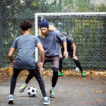 friends playing soccer outside | soccer around Manassas